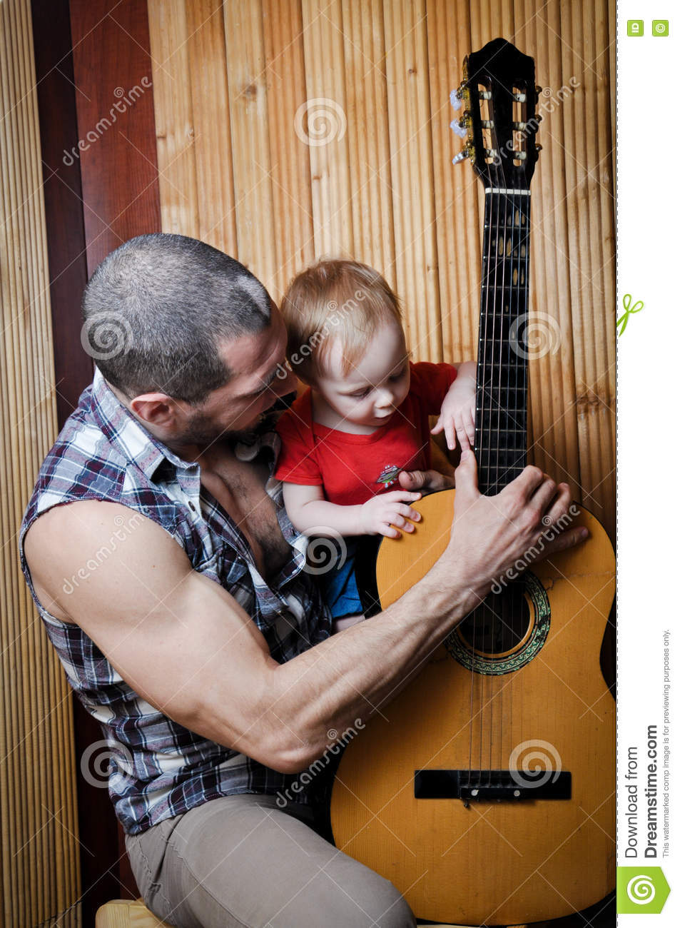 Little Baby Girl With His Hipster Father Playing Guitar On