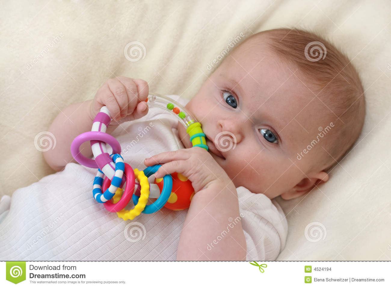 Little Baby Girl With Rattle Stock Images Image 4524194