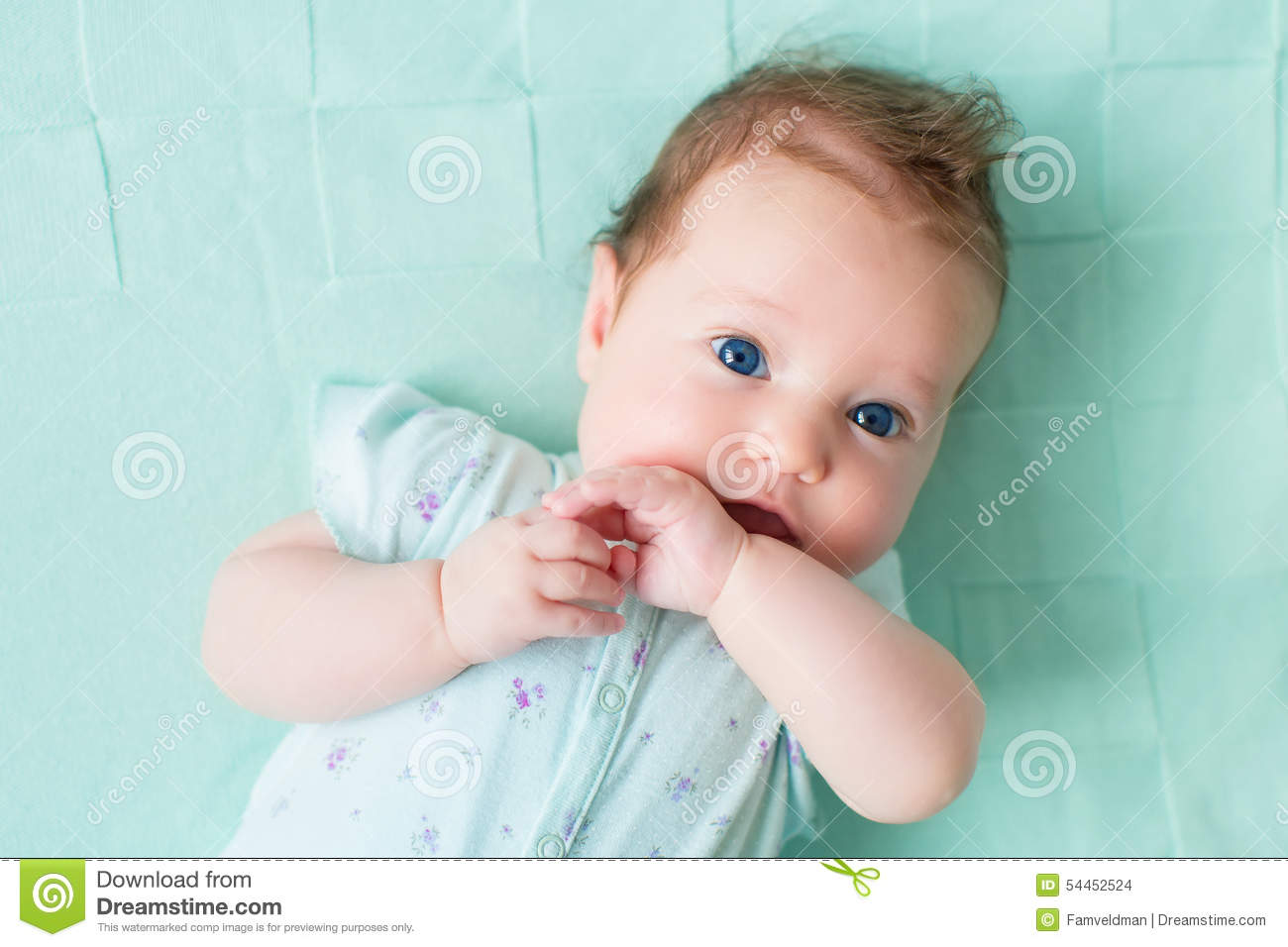 Newborn Baby Girl With Black Hair And Blue Eyes Adorable infant with blue eyes
