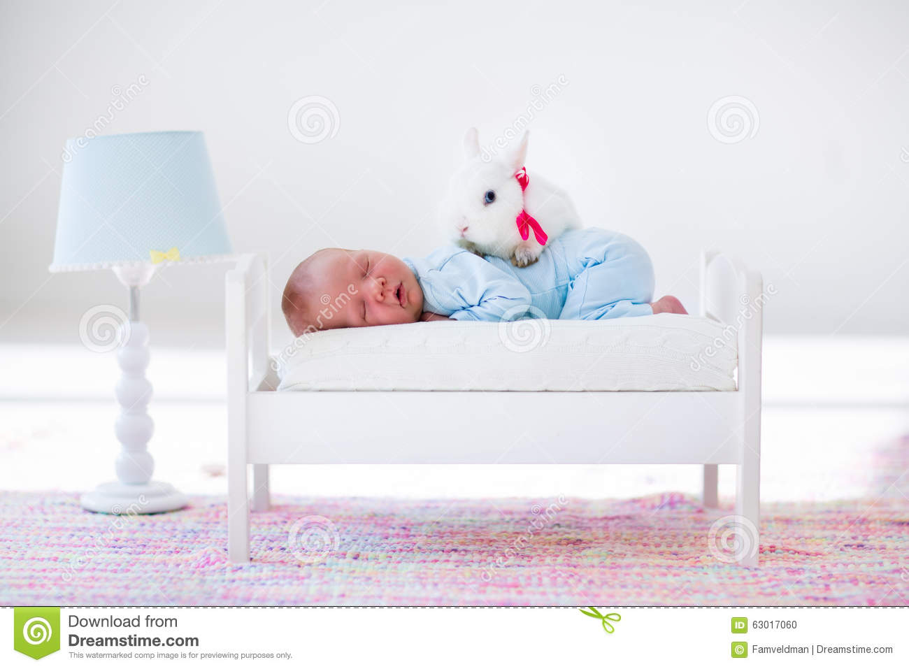 Little baby sleeping in toy bed with pat bunny stock photo for Sleeping bed