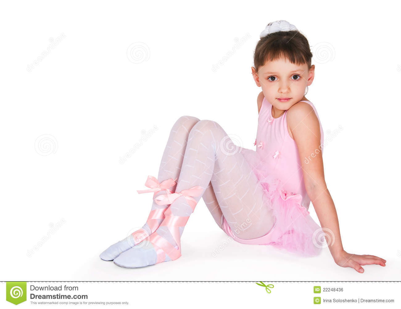 Full-length portrait of a little girls practicing her ballet kicks on ...
