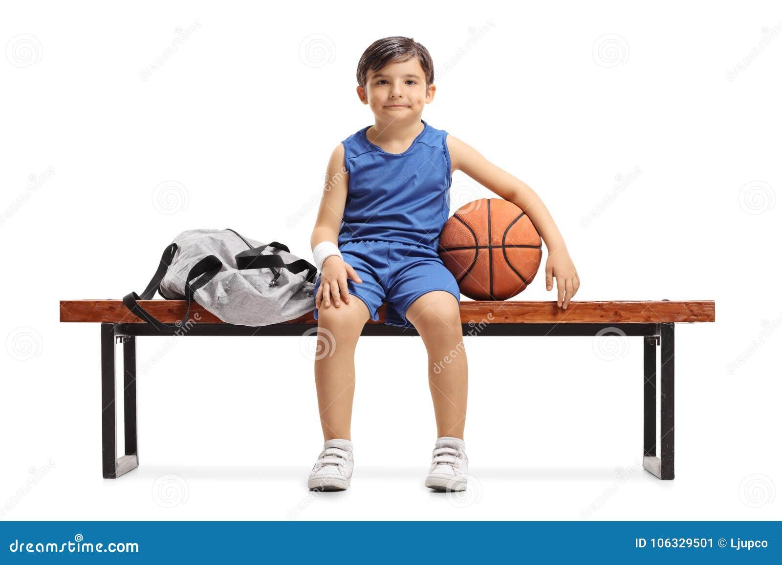 Awe Inspiring Little Basketball Player Sitting On A Wooden Bench Next To A Beatyapartments Chair Design Images Beatyapartmentscom
