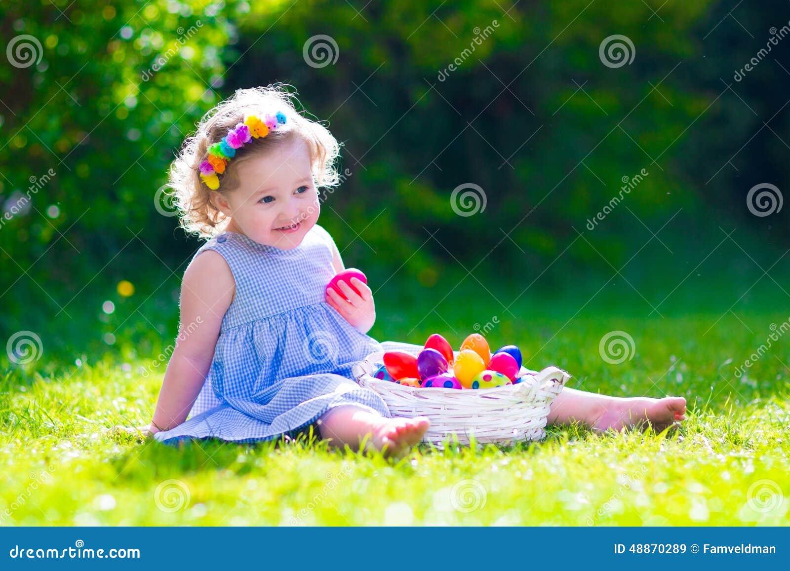 Little Beautiful Girl On Easter Egg Hunt Stock Photo - Image: 48870289