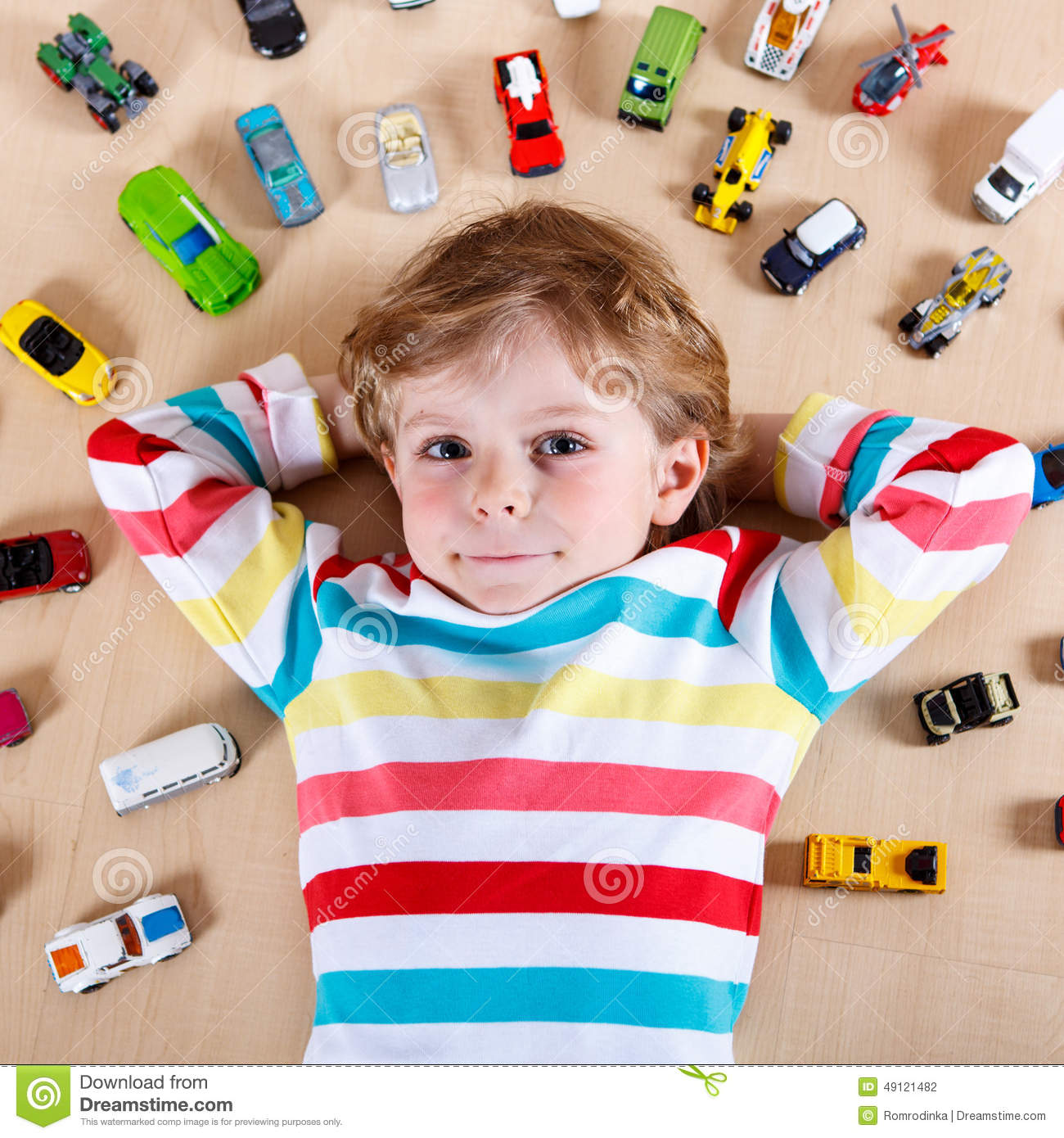 Unique Fun For Little Boys Toys : Little blond child playing with lots of toy cars indoor