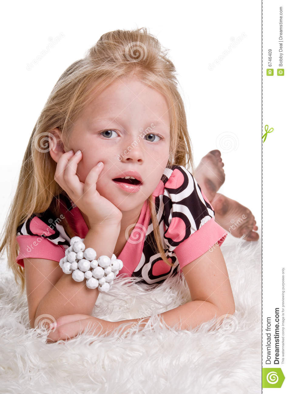 ... feather boa with a white pearl bracelet on her arm with dirty feet
