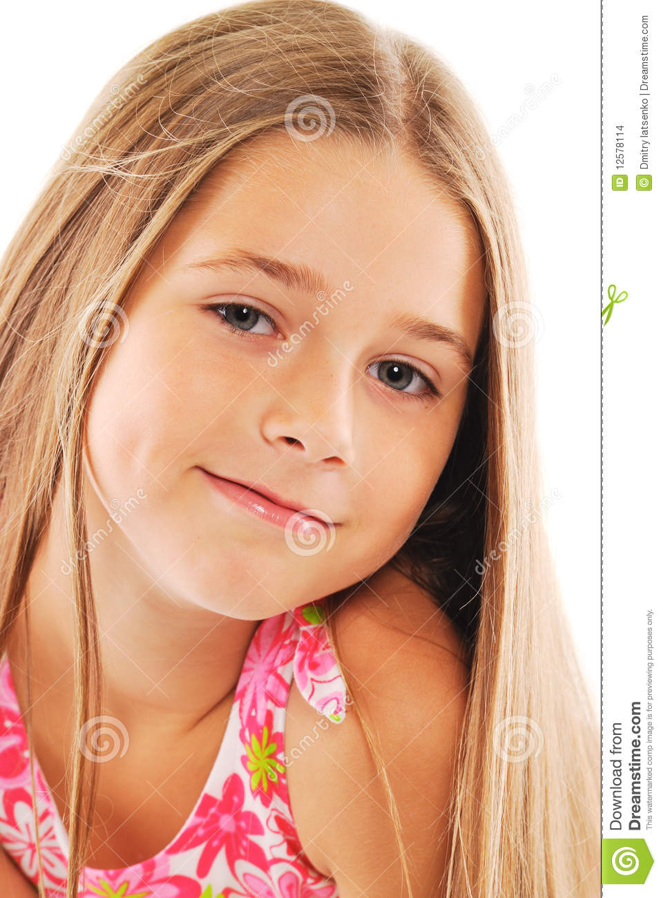 Portrait of little blond girl with long hair on white background.