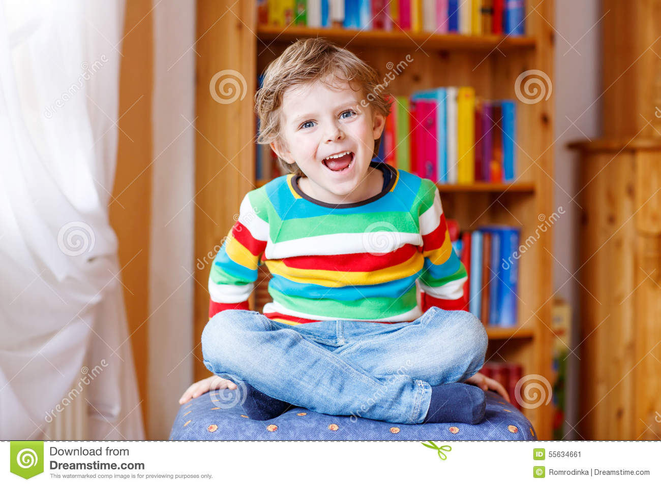 Little Blond Kid Boy Having Fun And Smiling Indoors Royalty Free Stock Photo