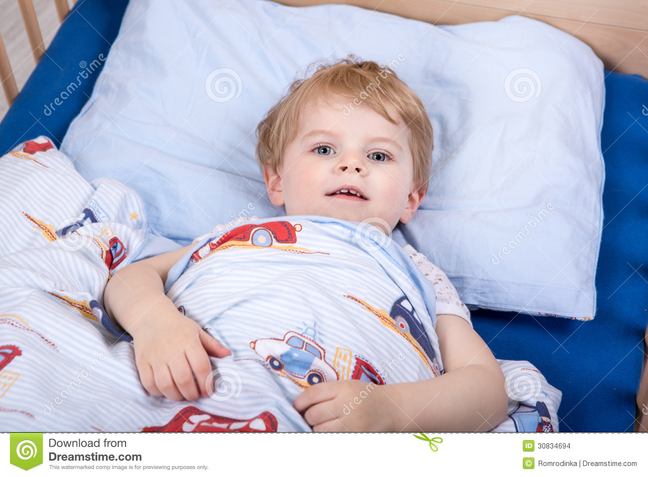 Little Blond Toddler Boy In Bed Stock Photo