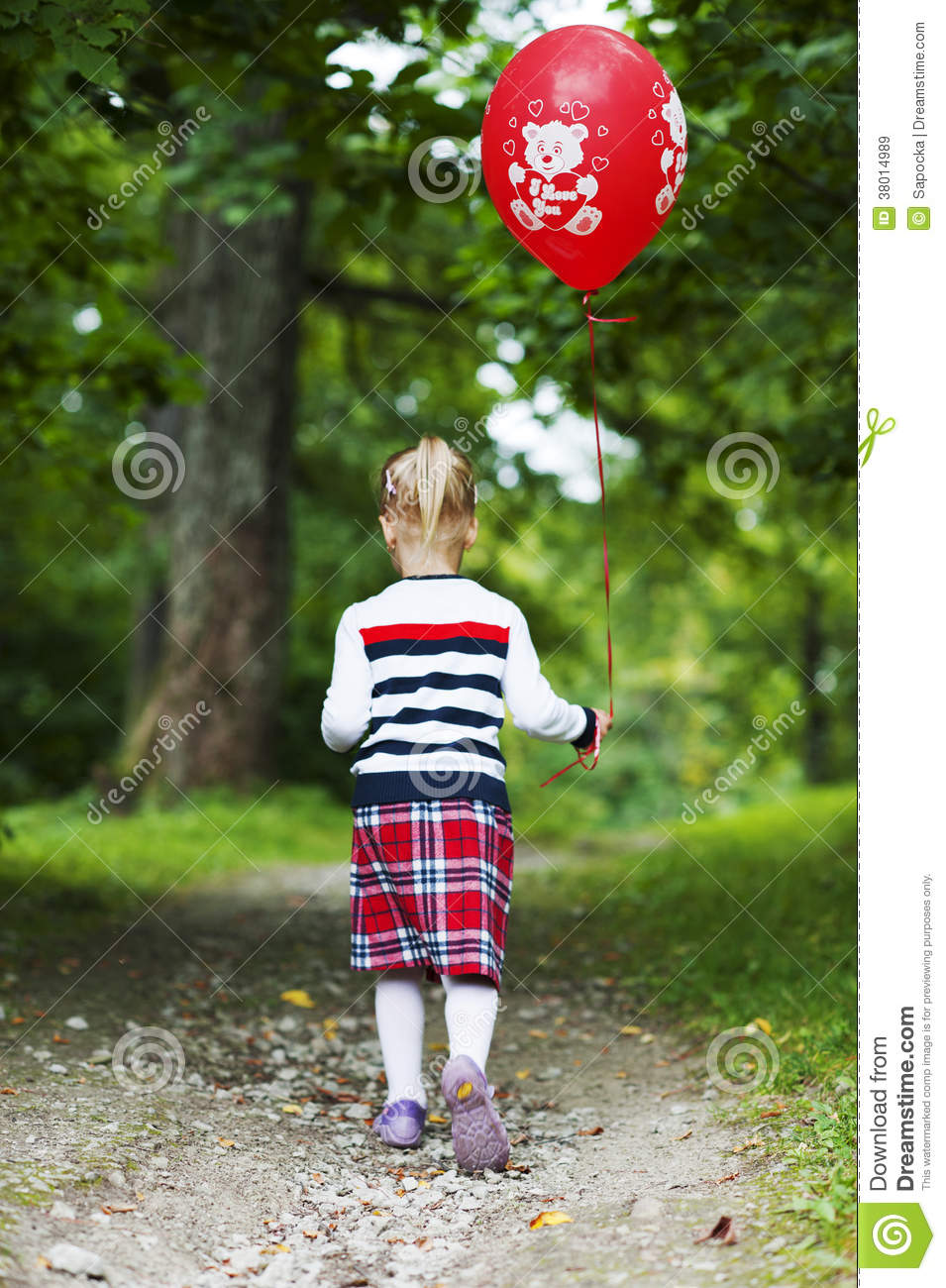 little blonde girl with red balloon walking on footpath