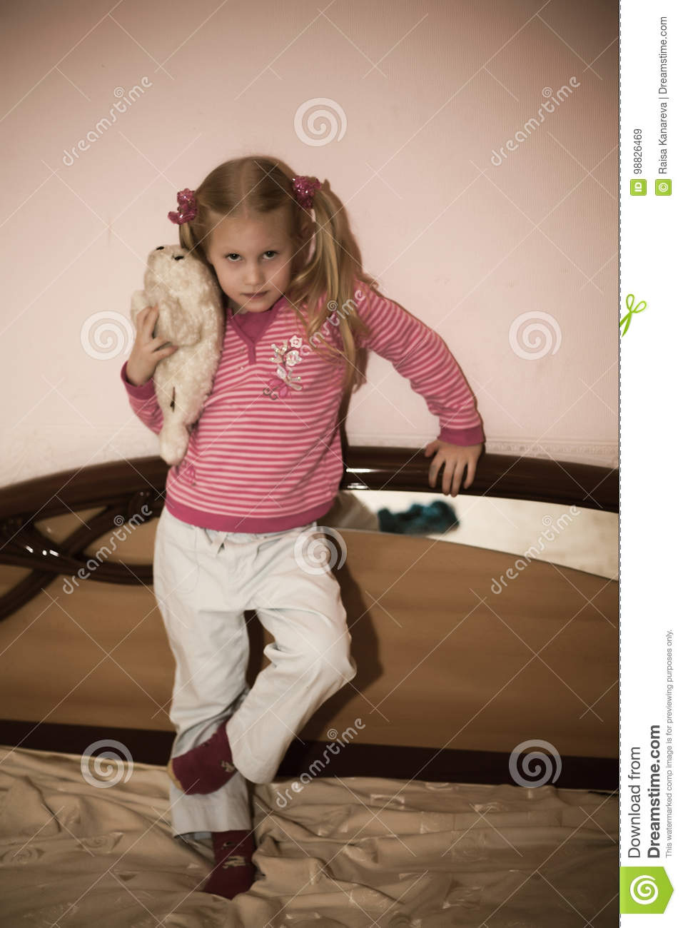 Blonde girl and toy