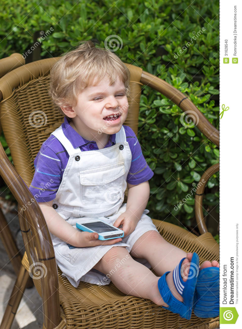 fe130e276916 Little Blonde Toddler Boy Playing With Cell Phone Stock Photo ...