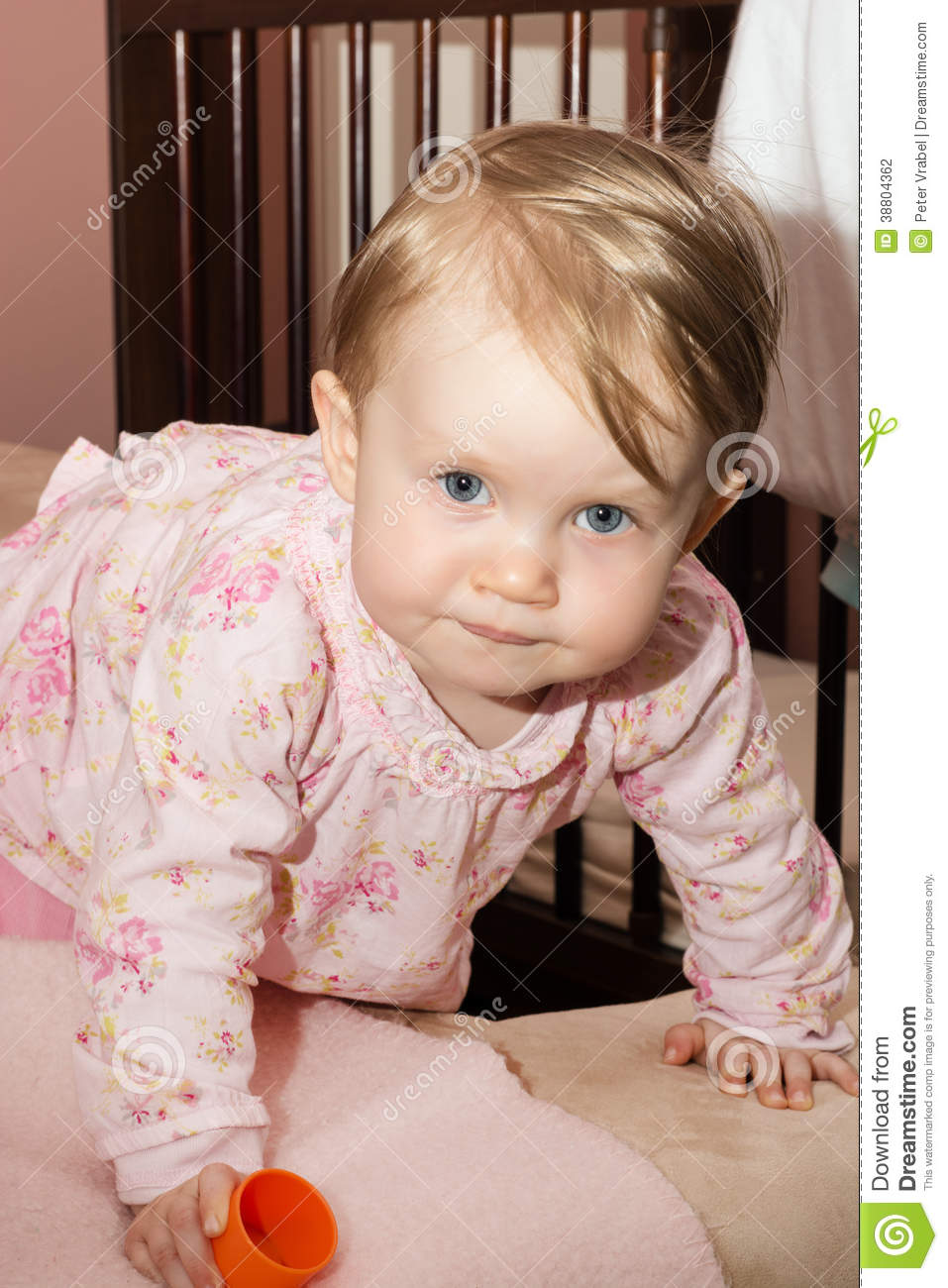 little blonde toddler girl is playing on the bed stock photo image 38804362. Black Bedroom Furniture Sets. Home Design Ideas