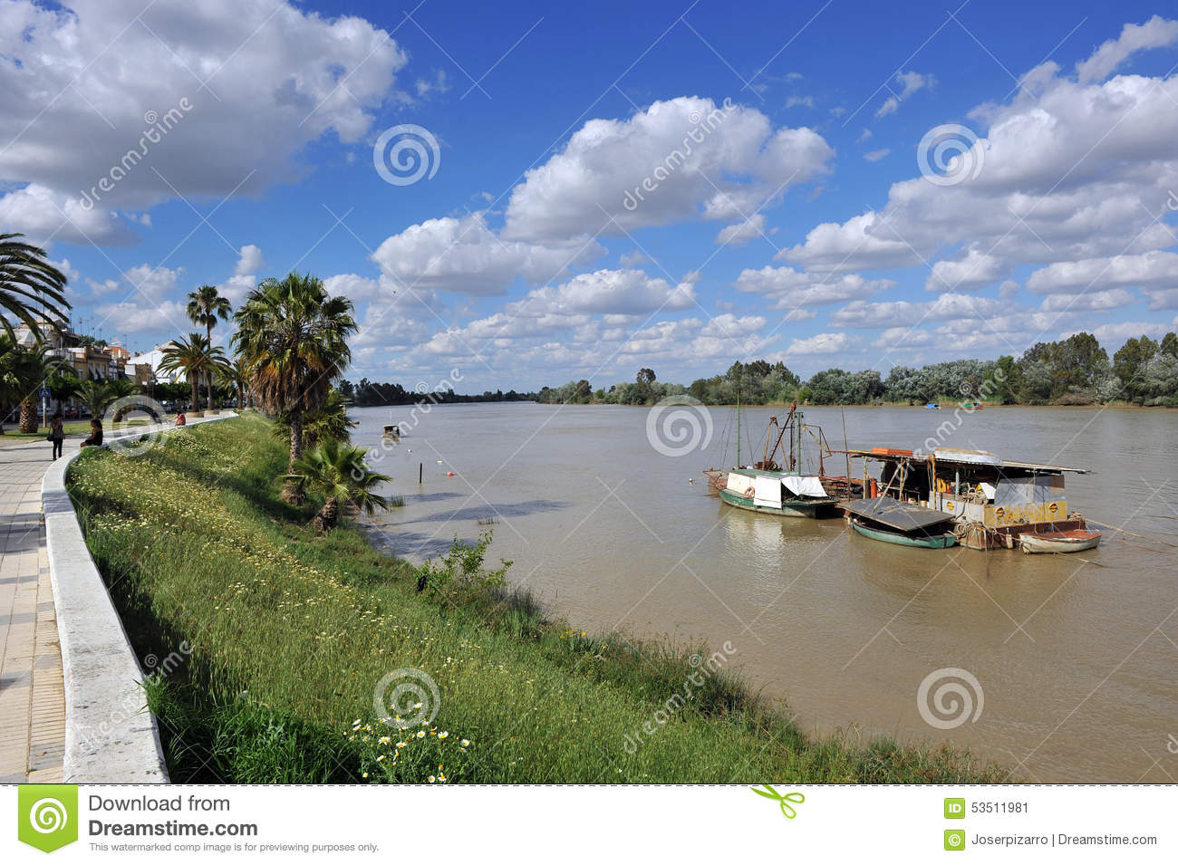 Little boats on the Guadalquivir River as it passes through Coria del Rio, Seville province, Andalusia, Spain
