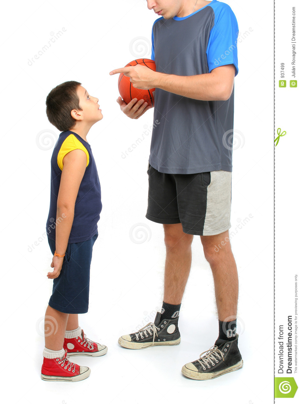 little boy asking big man to play basketball royalty free