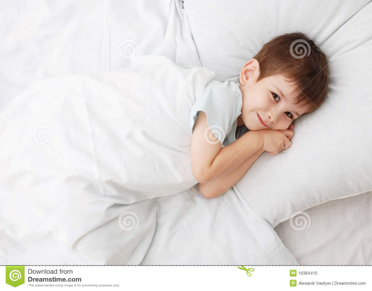 The Little Boy On A Bed Stock Photo - Image: 10384410