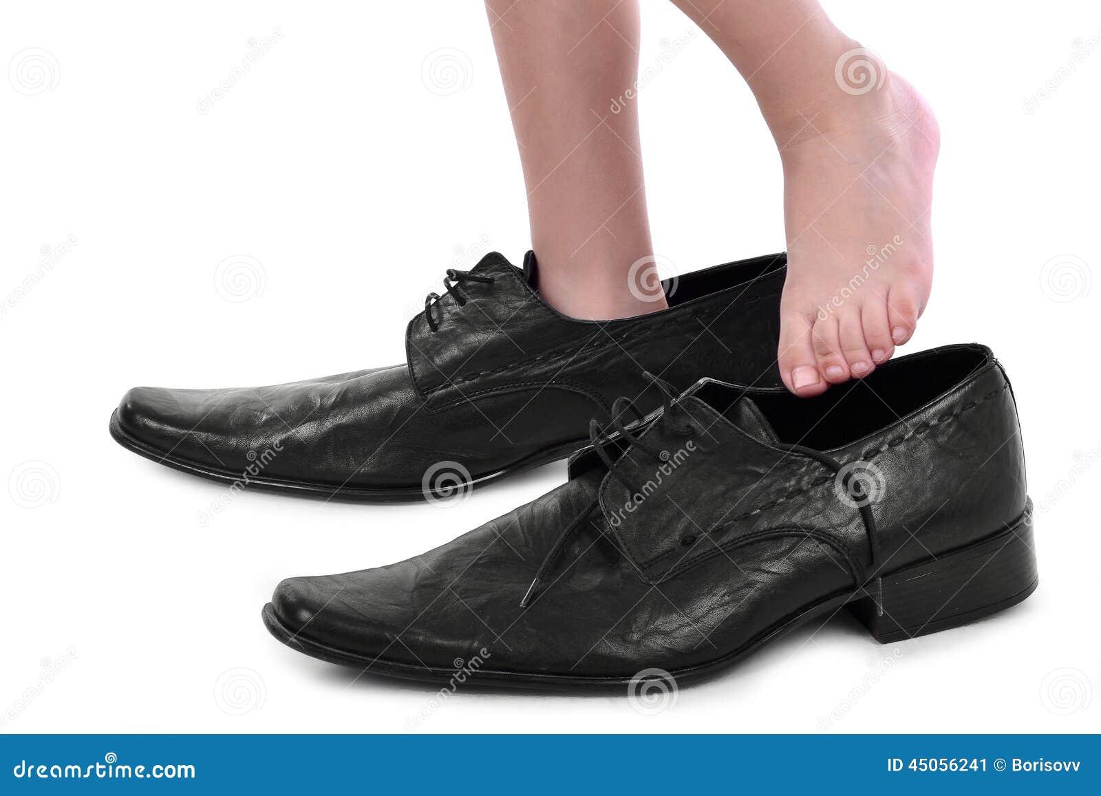 boy with big black shoes stock photo image 45056241