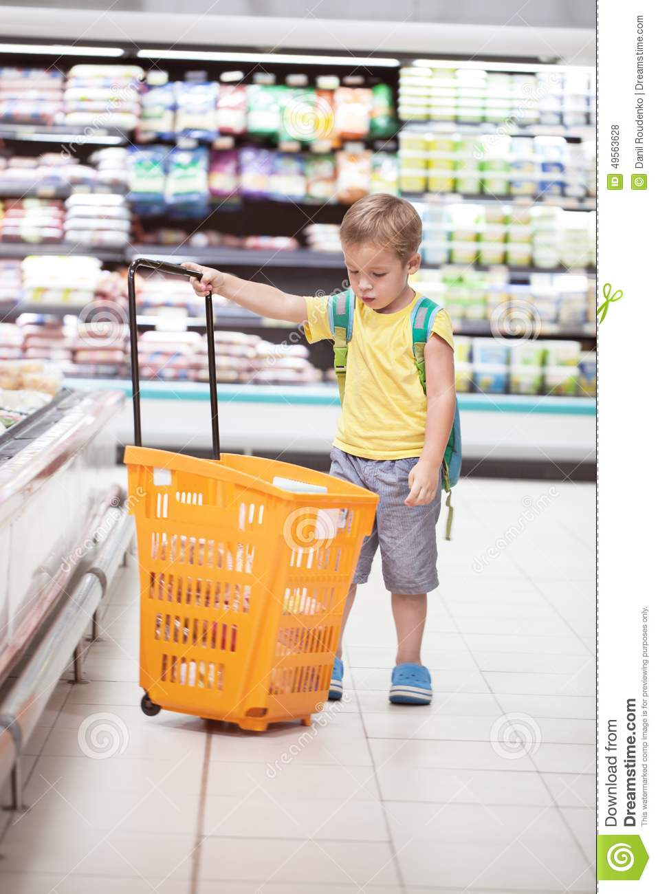 Lonely Boutique In Newmarket Auckland By Rufus Knight: Little Boy With Big Shopping Cart In The Store Stock Photo