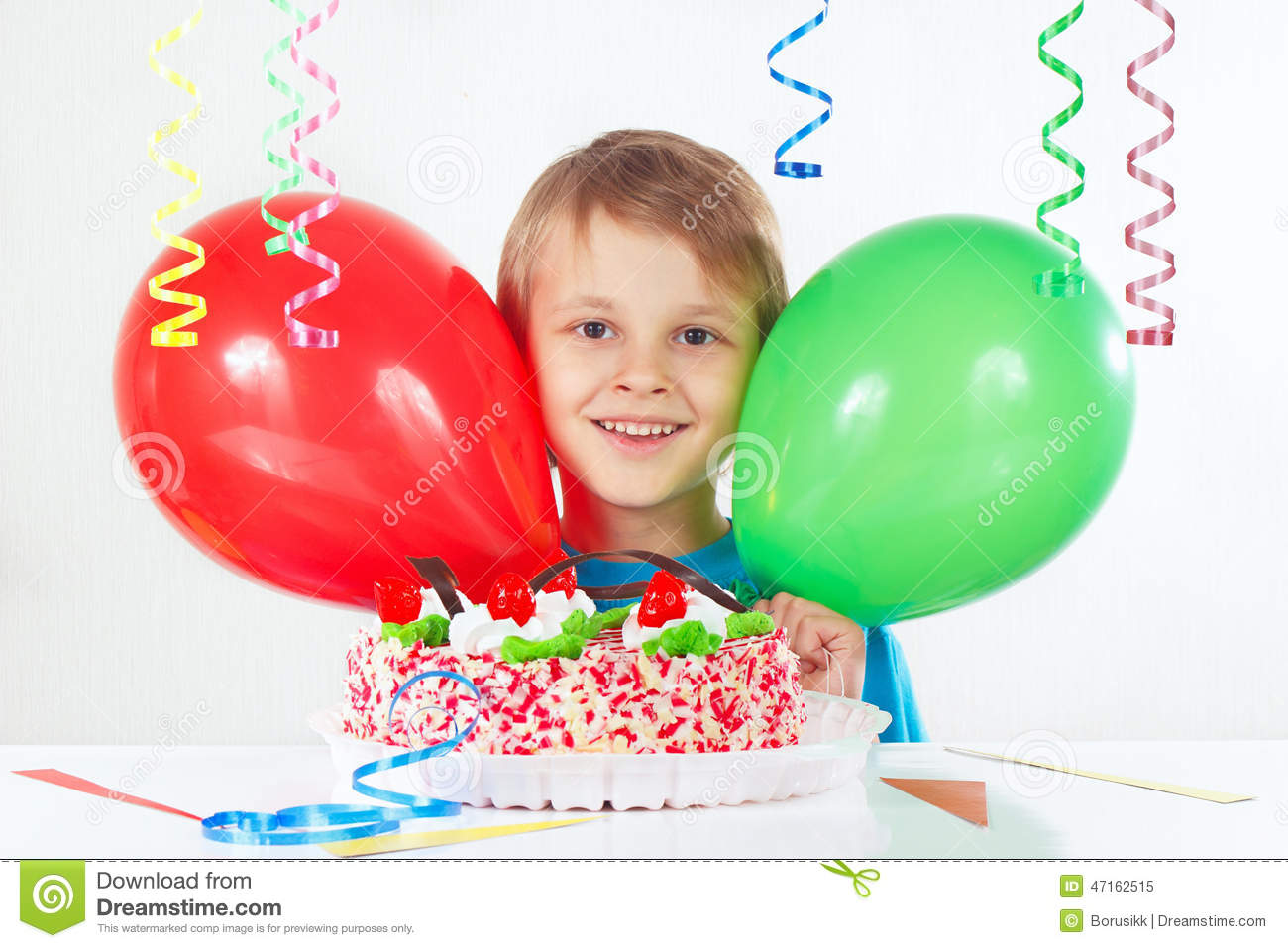 Little Boy With A Birthday Cake And Balloons On White Background