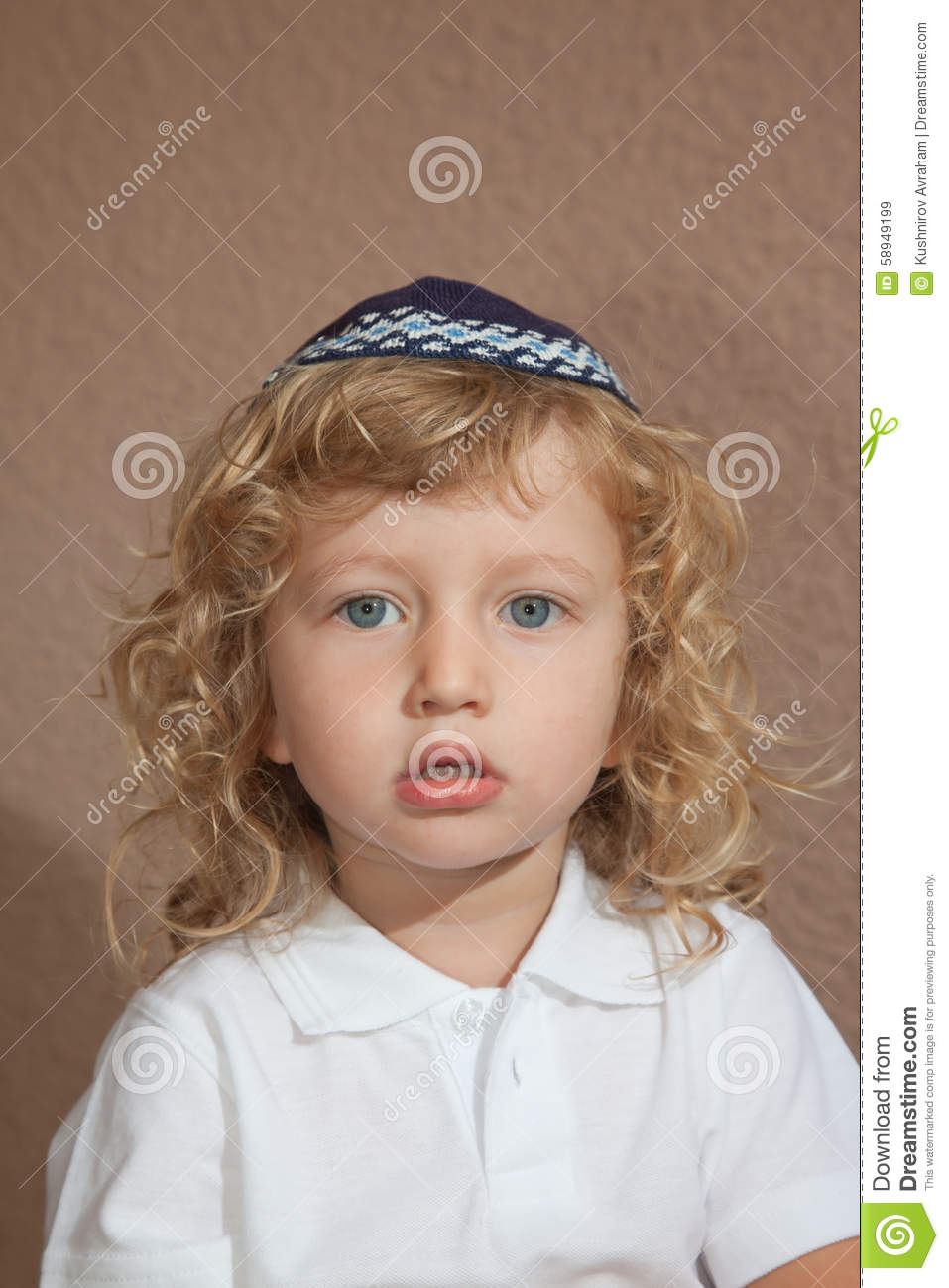 The Little Boy With Blue Eyes In Jewish Knitted Skullcap