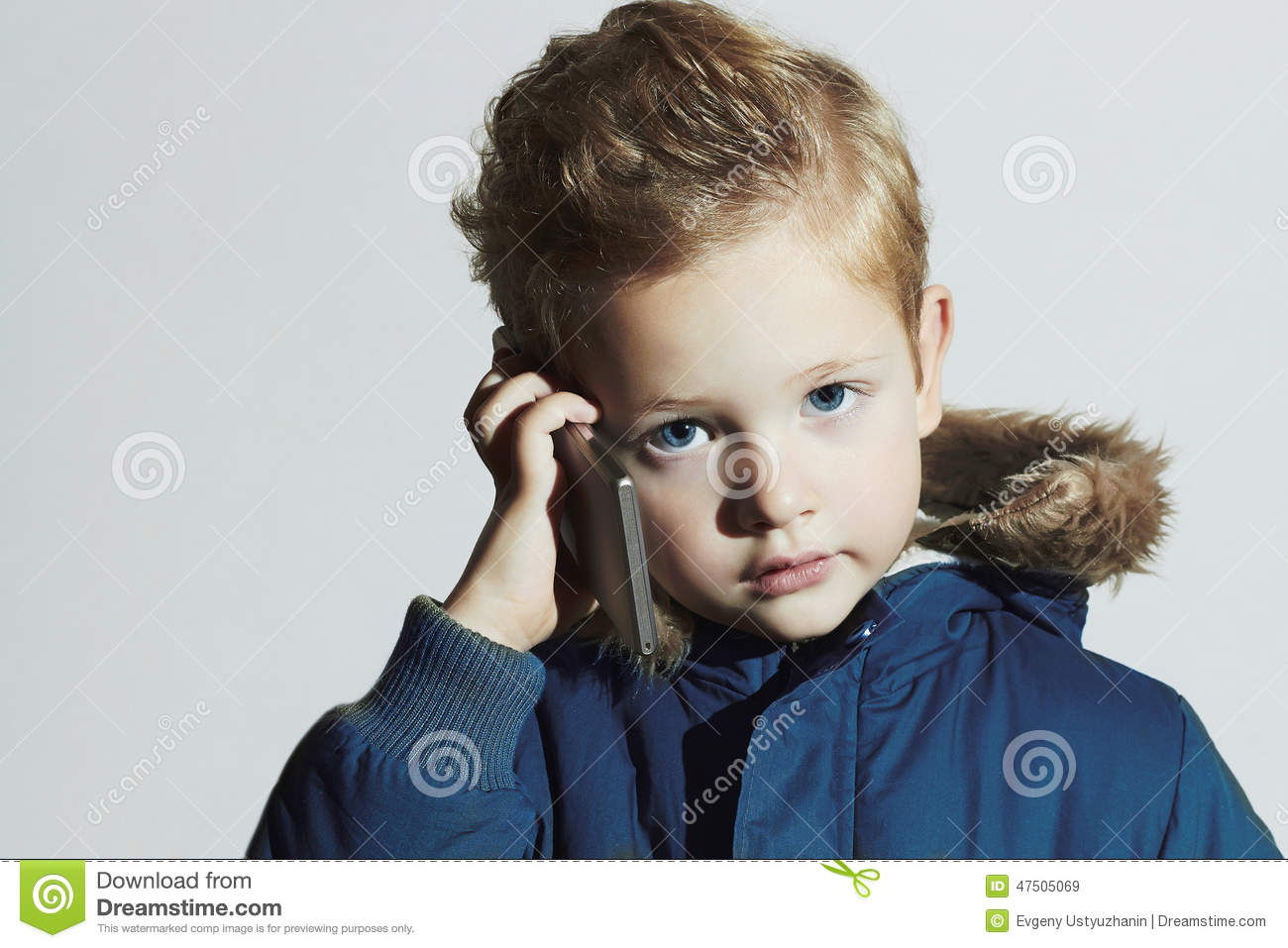 Little boy with cellphone modern child in winter coat fashion royalty free stock - Coupe cheveux enfant ...