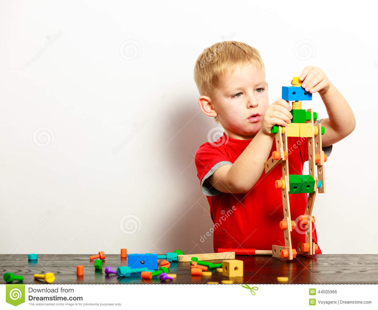 Building Toys For Little Boys : Little boy child playing with building blocks toys