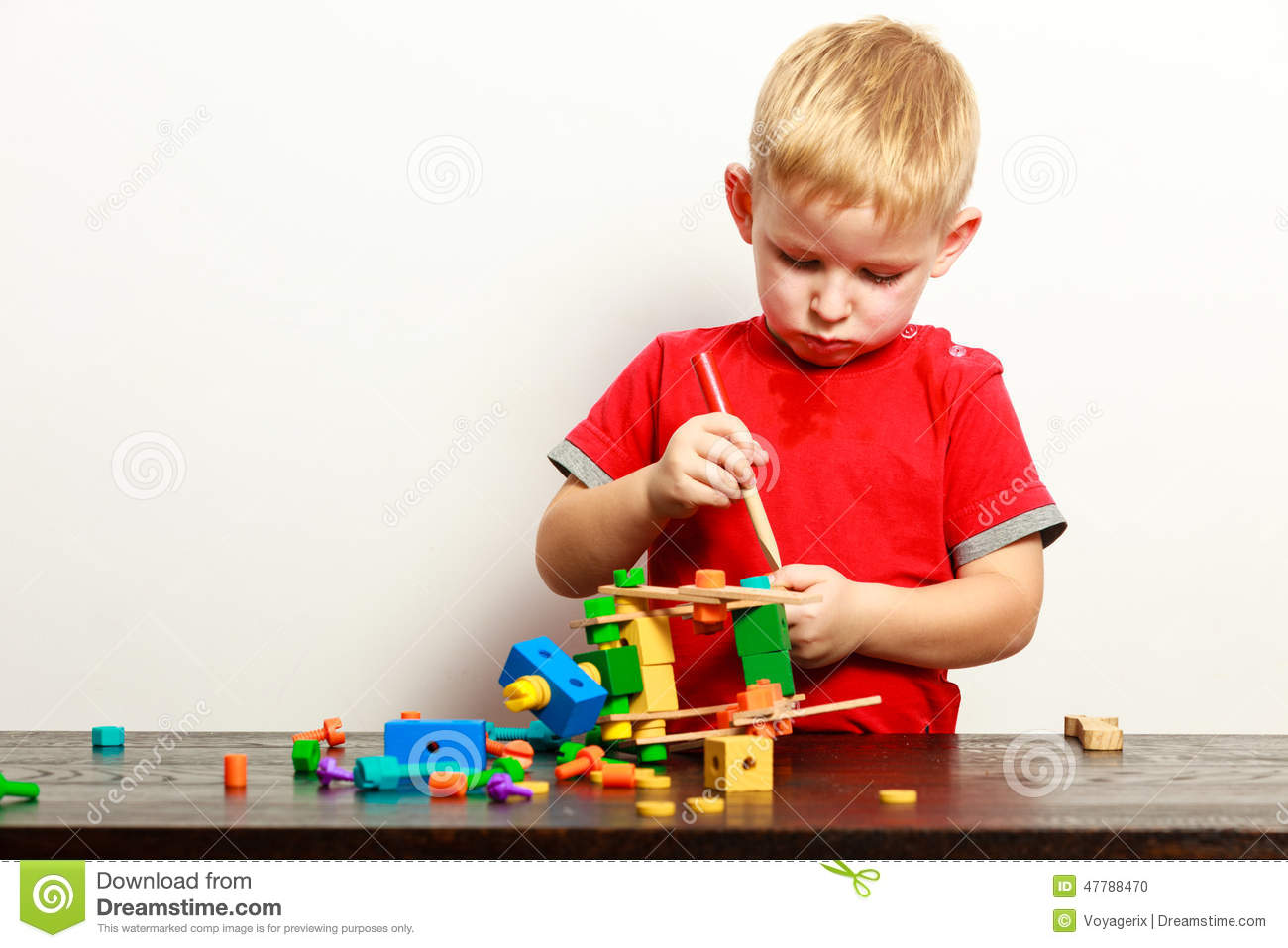 Building Toys For Little Boys : Little boy playing with construction toy blocks royalty
