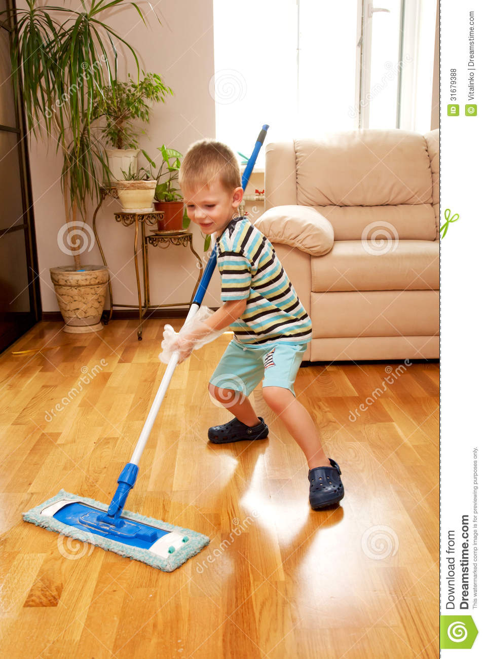 little boy cleaning apartment  little home helper  stock
