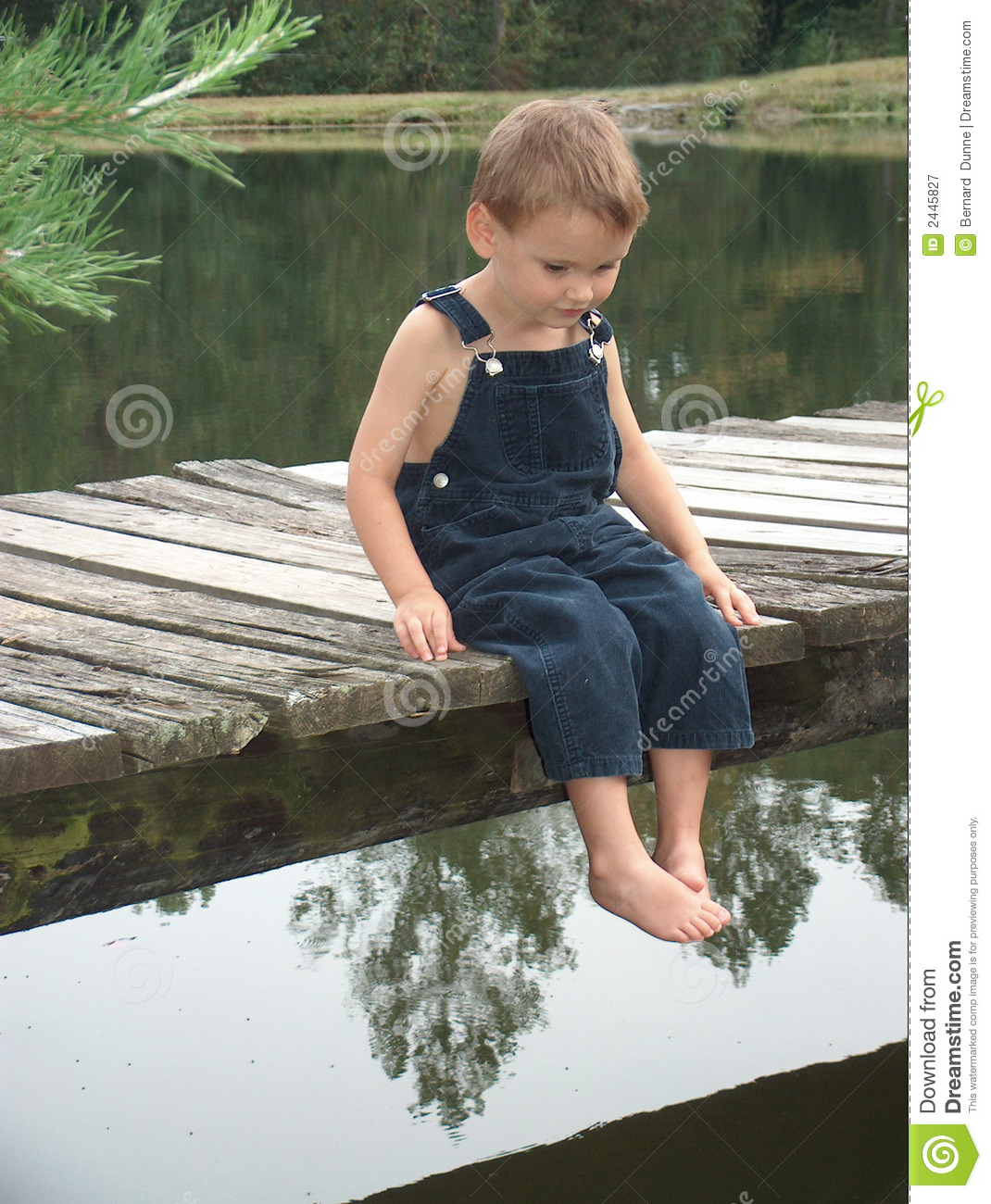 Little boy on dock royalty free stock photography image for Little boy fishing