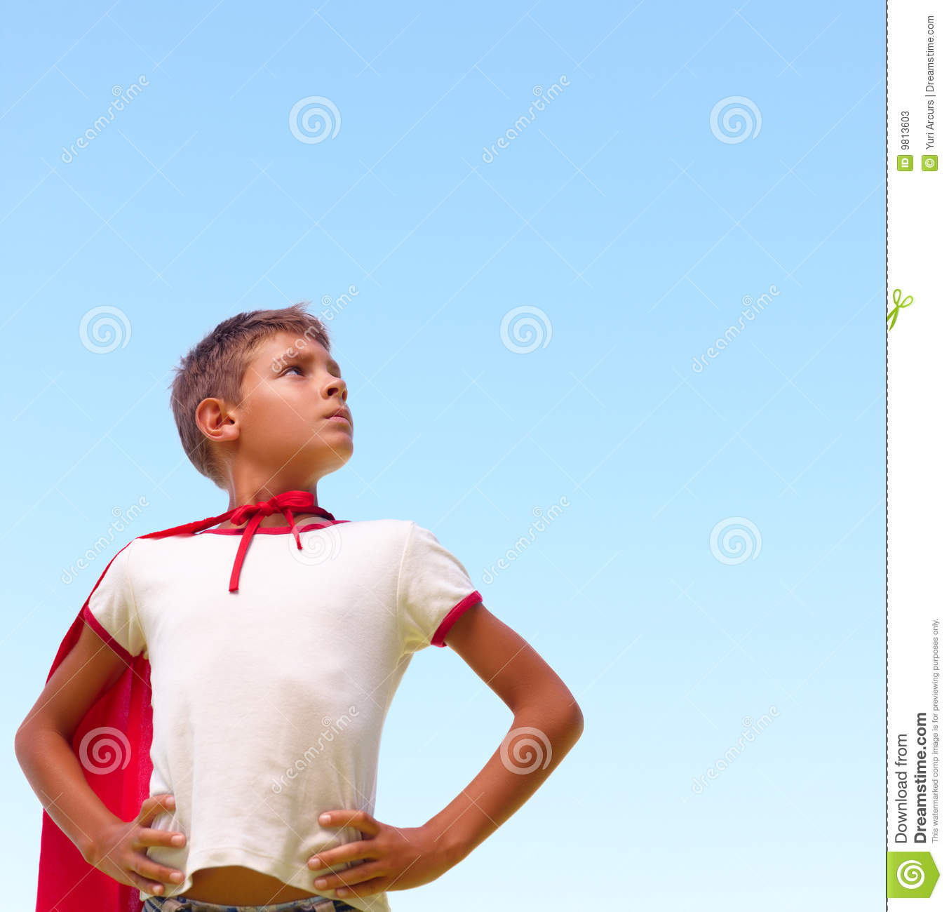 Little Boy Dressed Up As A Superhero Looking Away Stock