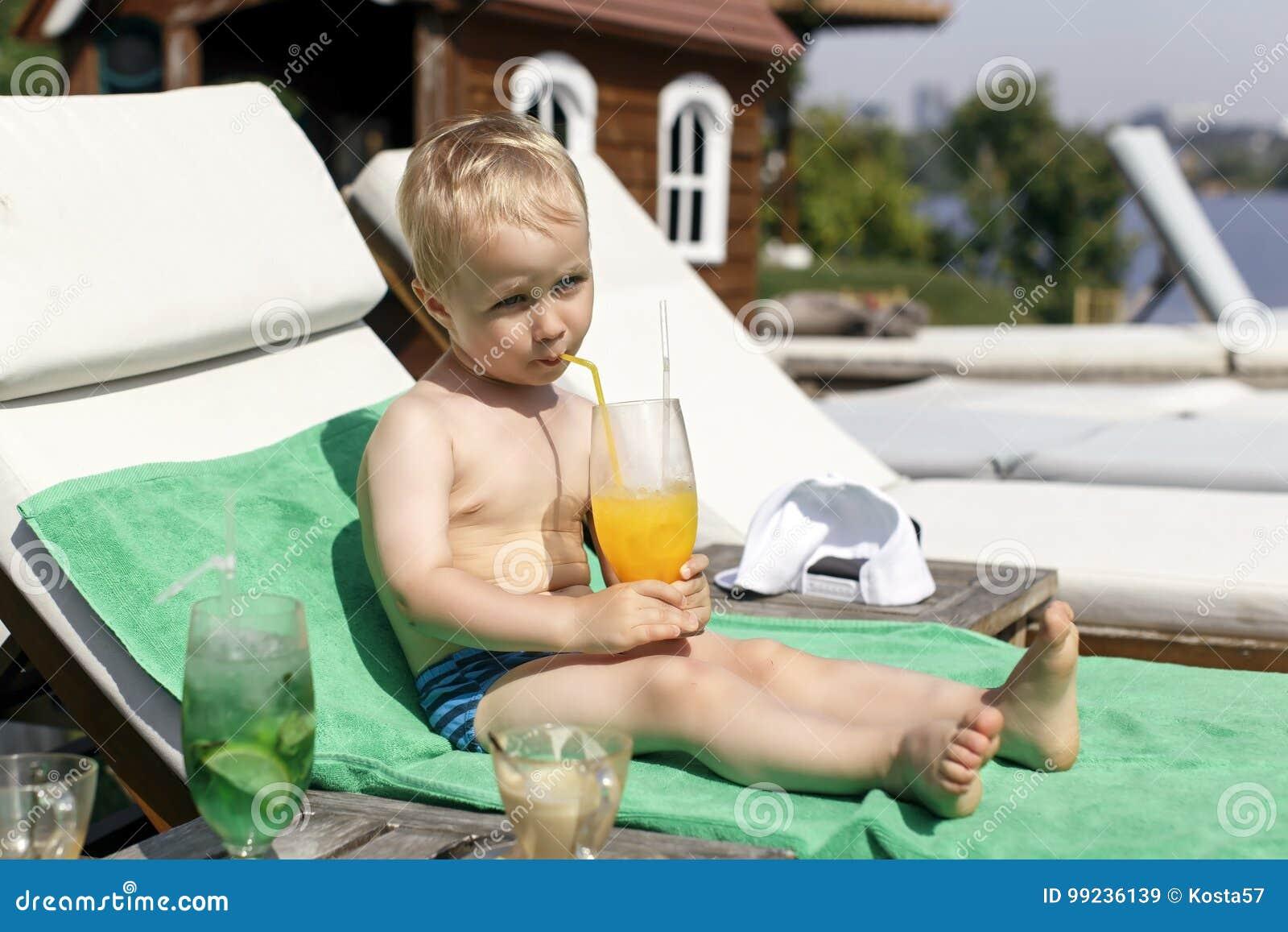 Little boy drinks a cocktail