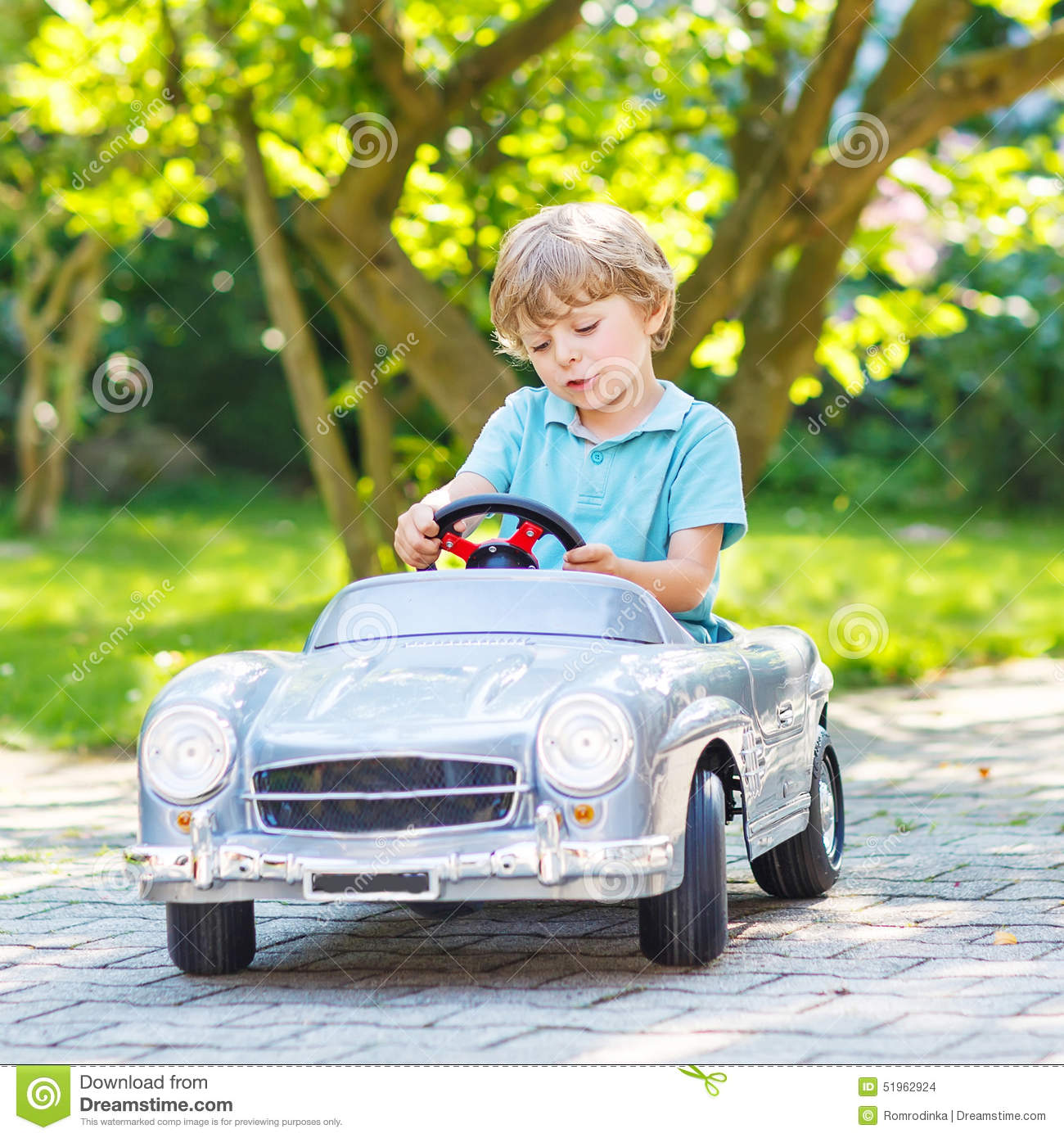 Unique Fun For Little Boys Toys : Little boy driving big toy old car outdoors stock photo