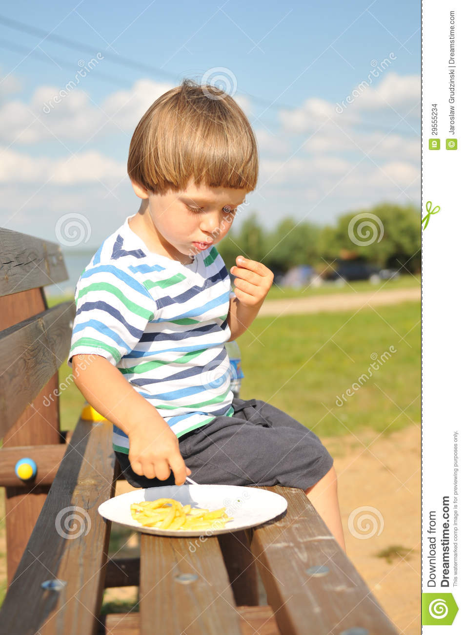 Little boy eating french fries