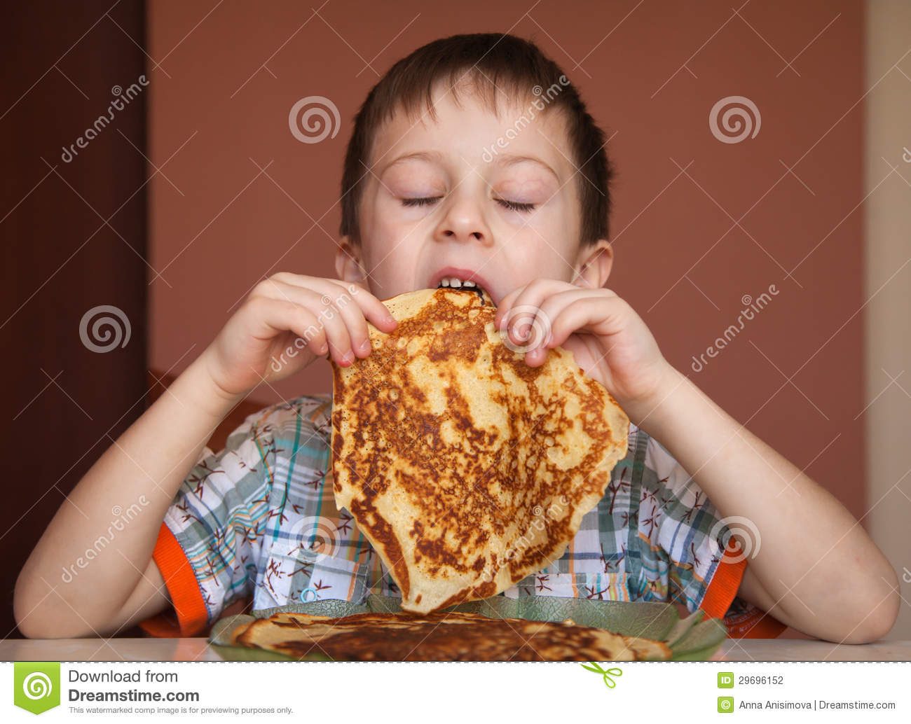 Little Boy Is Eating Pancakes Stock Photography - Image ...