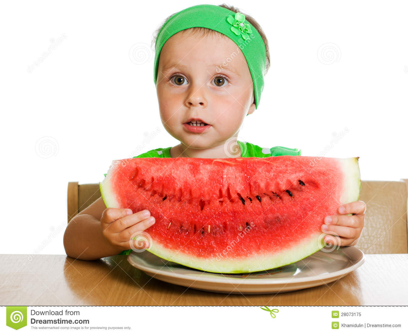 Little boy eating a watermelon at a table royalty free for Eating table