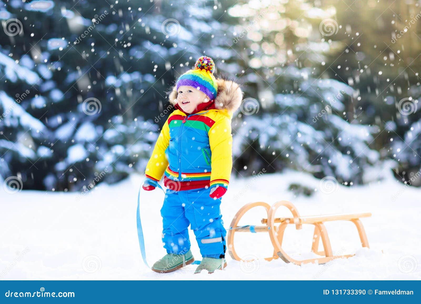 Christmas Vacation Sled.Little Boy Enjoying A Sleigh Ride Child Sledding Toddler