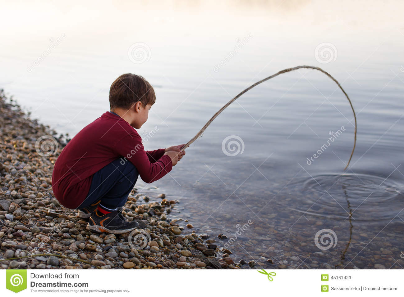 Little boy fishing with branch stock photo image 45161423 for Little boy fishing