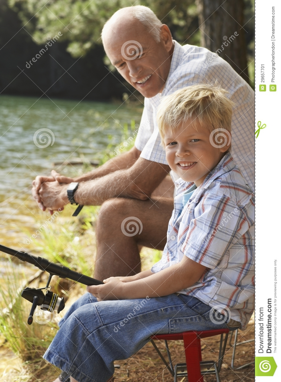Little boy fishing with grandfather stock image image for Little boy fishing