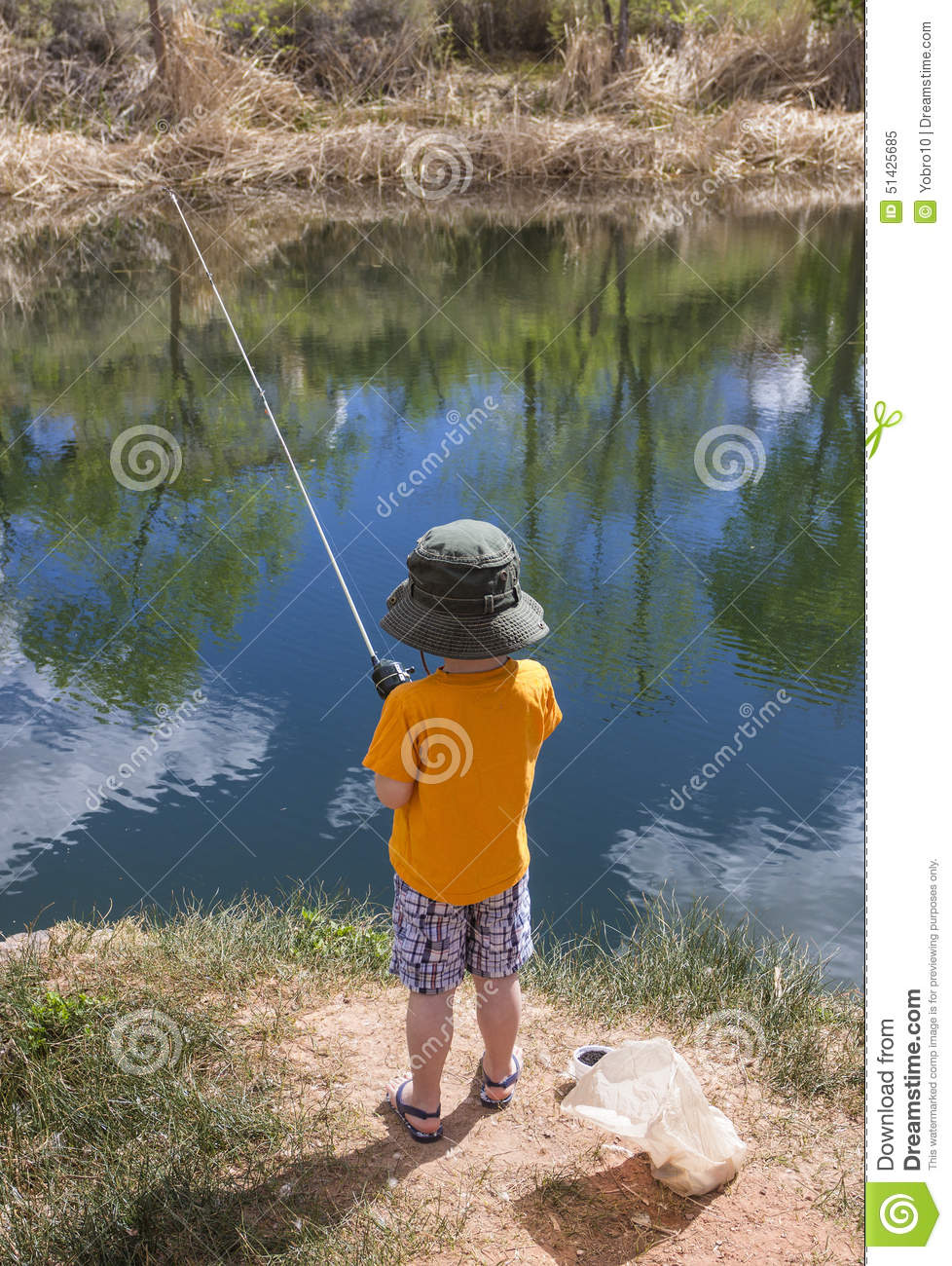 Little boy fishing in a pond stock image image 51425685 for Little boy fishing