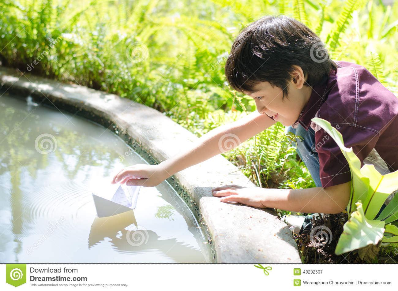 Little Boy Floating Paper Boat Stock Photo - Image: 48292507