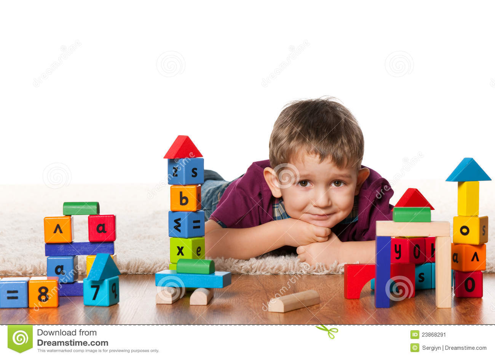 Little Boy Toys : Little boy on the floor near toys stock image