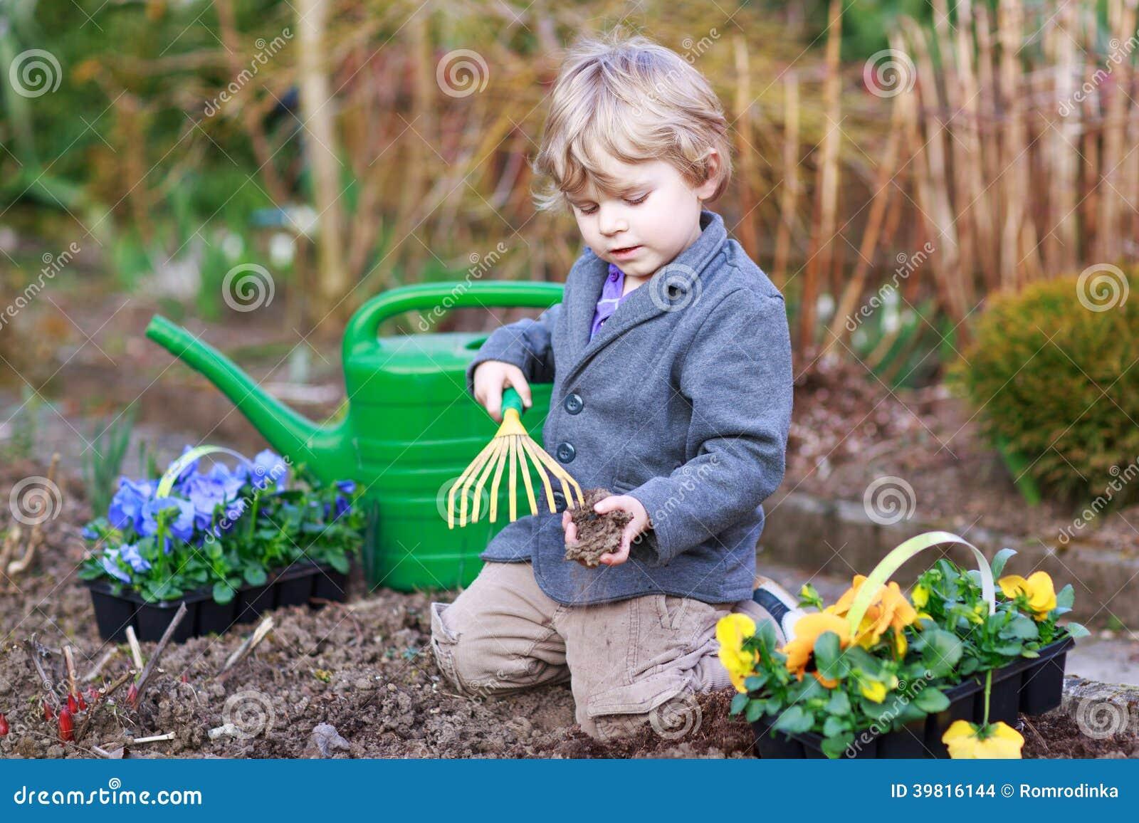 Boy Models Garden Of Flowers