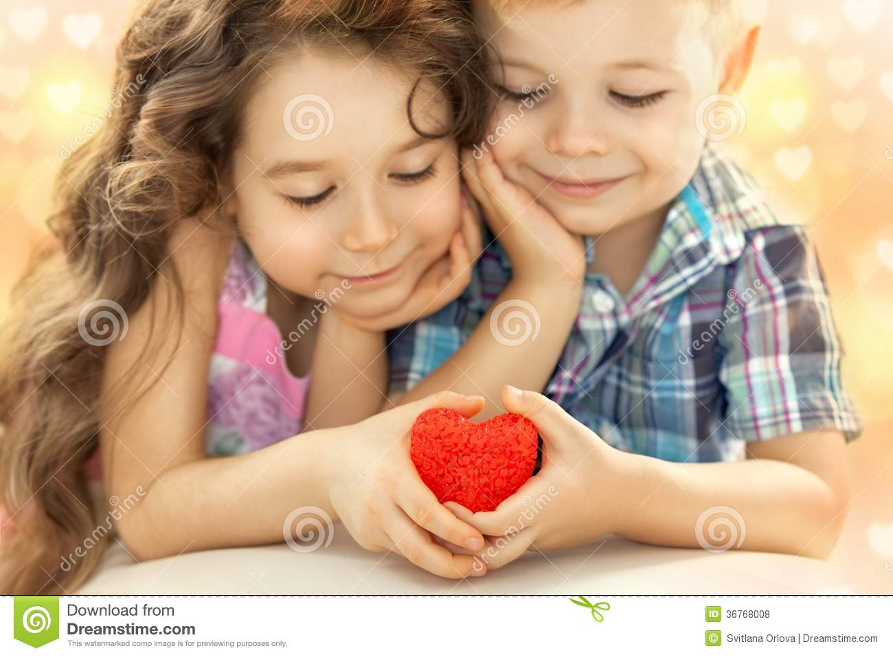 Little Boy And Girl Holding In Hands Red Heart Stock Photo Image