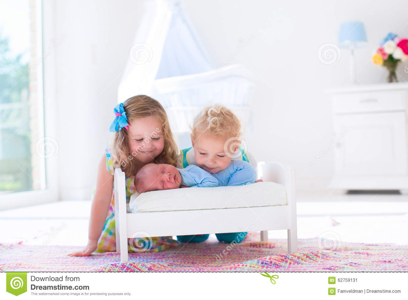 Little boy and girl meet new sibling stock photo image for Boys and girls in bed