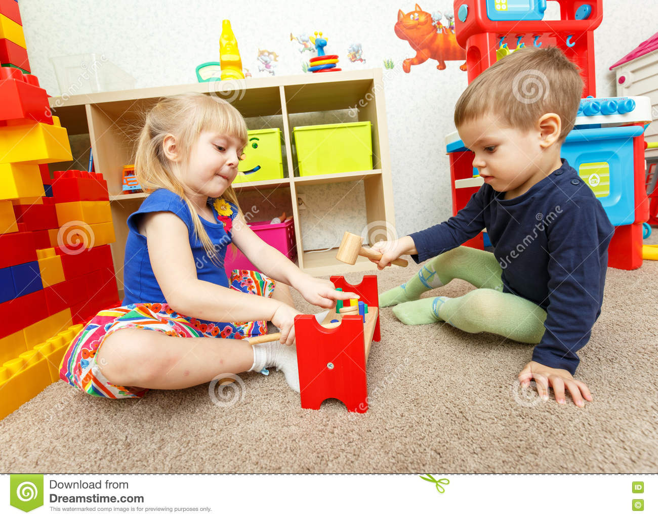 Toys For Boys Kindergarten : Little boy and girl play with toy hammer in kindergarten