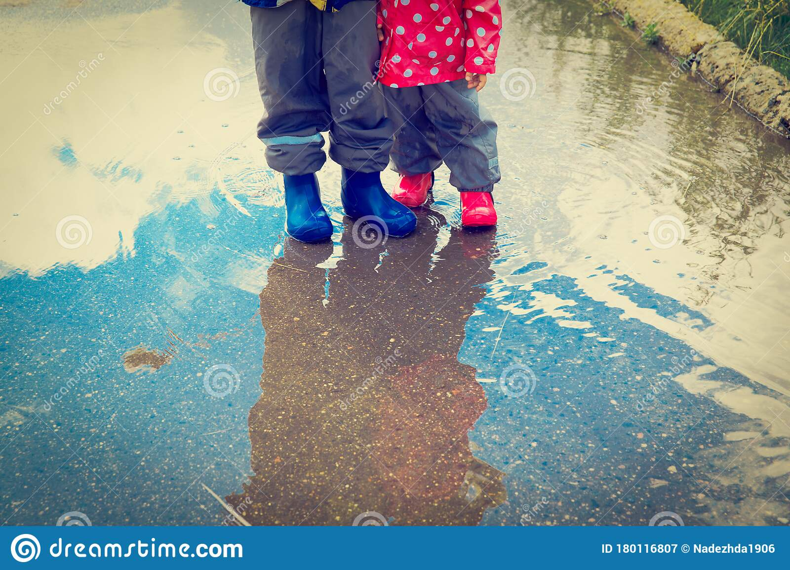 Boy And Girl Playing In Water Pool Stock Image - Image: 24561