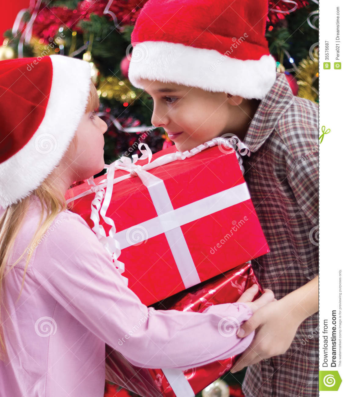 Little Girl Christmas Tree: Little Boy And Girl Smiling With Present Near The