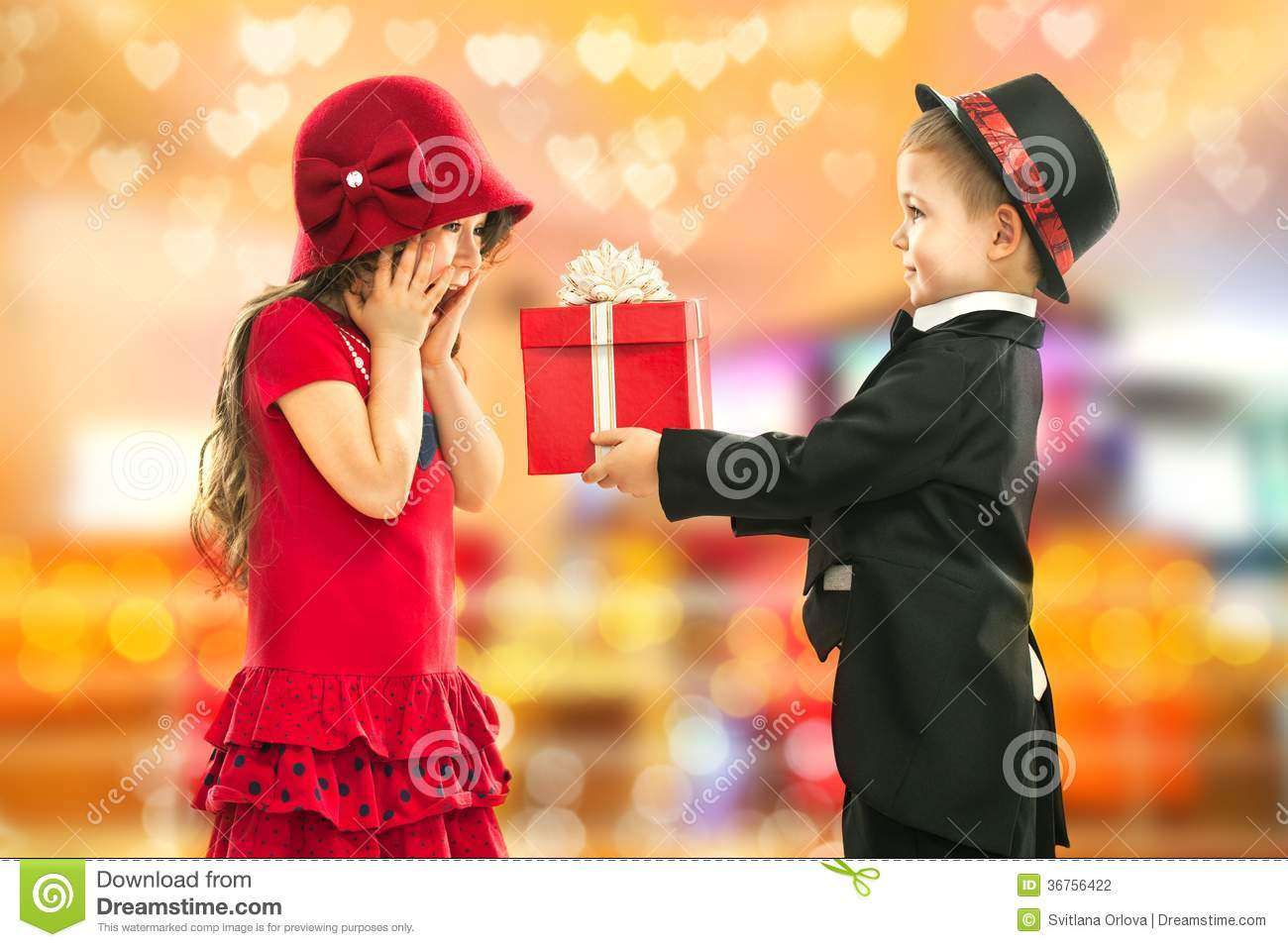 Little Boy Giving Girl Gift And His Excited Stock