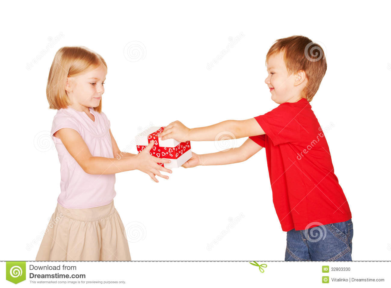 Little Boy Giving A Little Girl A Gift Stock Photo