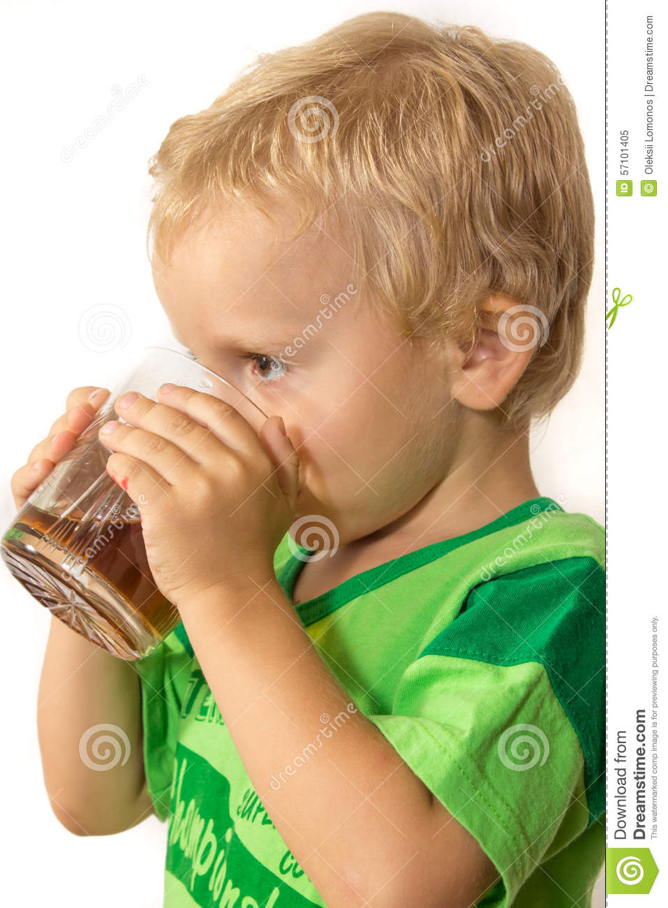 Little Boy In A Green T Shirt Happily Drinking Tea Stock Image
