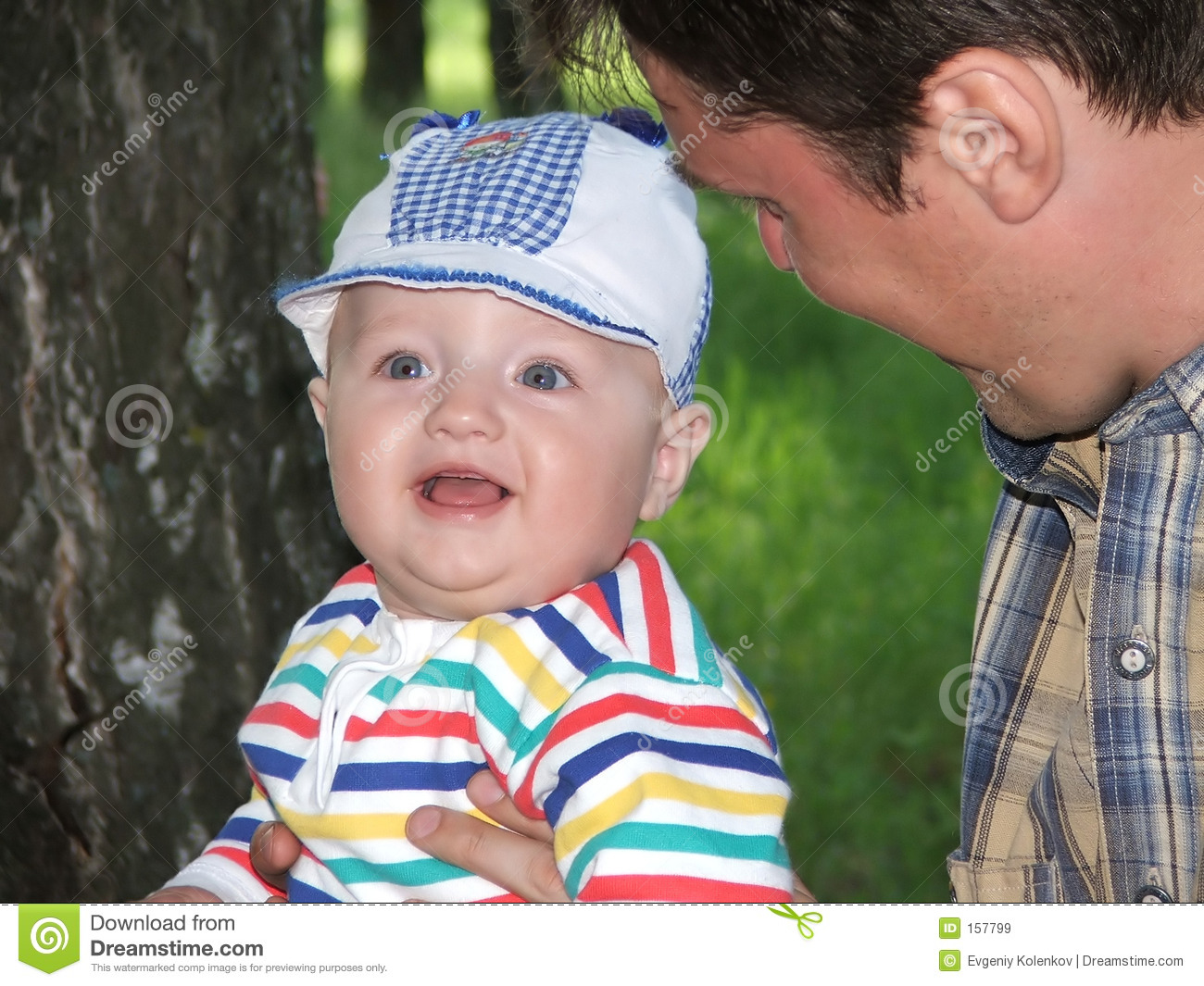 The little boy on hands of father.